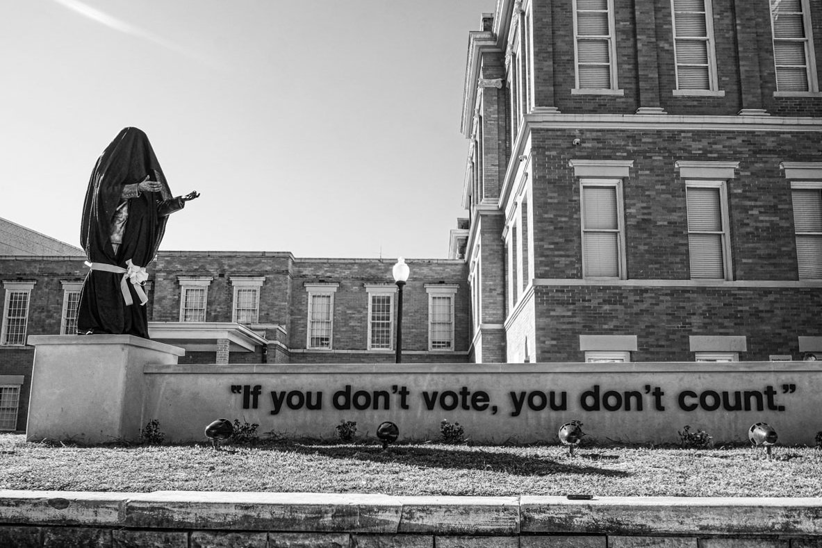 "The statue of slain voting rights leader Vernon Dahmer, seen here before its unveiling, includes his famous words: ""If you don't vote, you don't count."" Photo by Ashton Pittman."