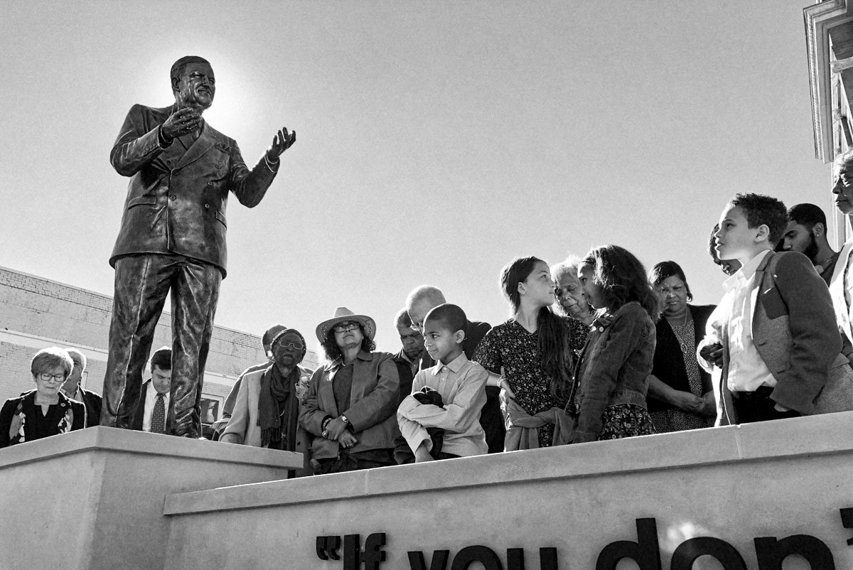 Family and friends gathered around a statue dedicated to voting rights activist Vernon Dahmer in Hattiesburg, Miss., on Jan. 6, 2019. Photo by Ashton Pittman.